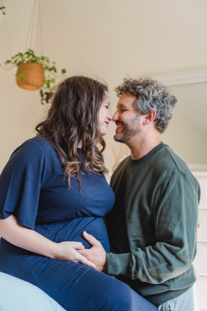 prenatal vitamins for pregnancy is main thing.Happy husband with a pregnant mom