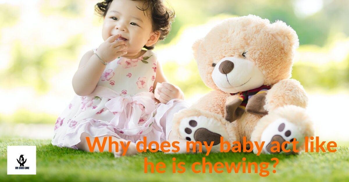 Abeautiful baby girl chews something